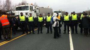 RCMP protecting SWN vehicles, Nov 14, 2013.