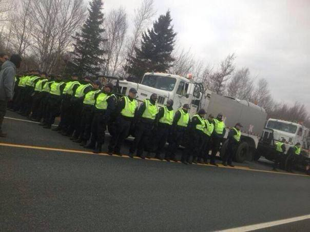 "RCMP surround ""thumper"" seismic testing vehicles contracted by SWN Resources, Nov 14, 2013."