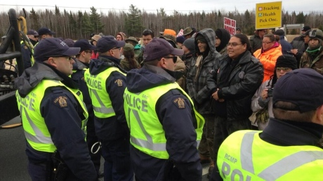 The people confronting the RCMP as they protect SWN trucks and equipment, Nov 14, 2013.
