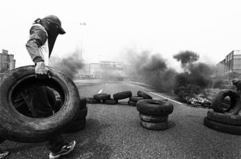 Piqueteros in Argentina establishing a fire tire blockade, 2000.