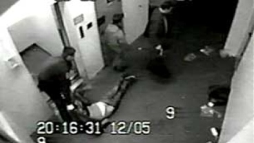 Vancouver police dragging an unconscious Frank Paul out of the lockup to deposit him in an alley.