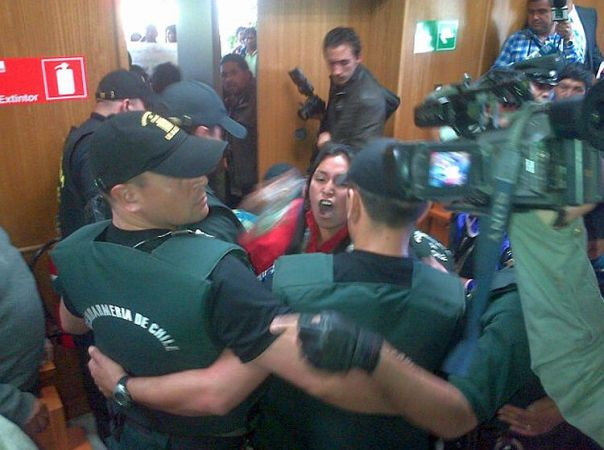 Family members react to conviction of Mapuche youth in court, Dec 5, 2013.