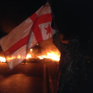Masked Mi'kmaq warrior at tire fire blockade on Hwy 11, Dec 2, 2013.