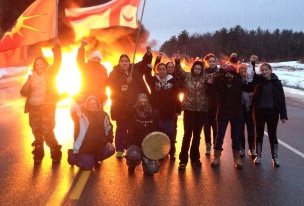 Women warriors at a tire fire blockade on Hwy 11, Dec 2, 2013, during resistance to SWN exploratory work for fracking.