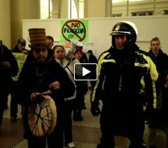 At Waterfront Station, Noel Abrahams (with cedar top hat) welcomes Vancouver cop into circle, Dec 2, 2013.