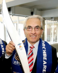 Phil Fontaine with 2010 Winter Olympics torch, when he was working for the Royal Bank of Canada.