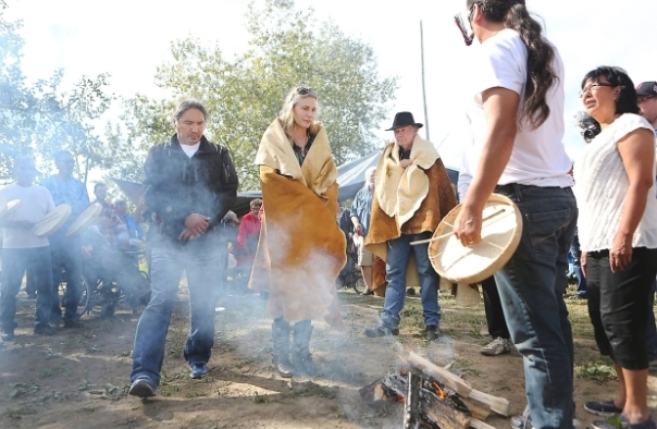 Photo: Actress Daryl Hannah, second from left, and musician Neil Young, centre, with Dene Chief Allan Adam, left, during a visit to the Chipewyan Prairie First Nation in September. Credit: Joey Podlubny Photography.