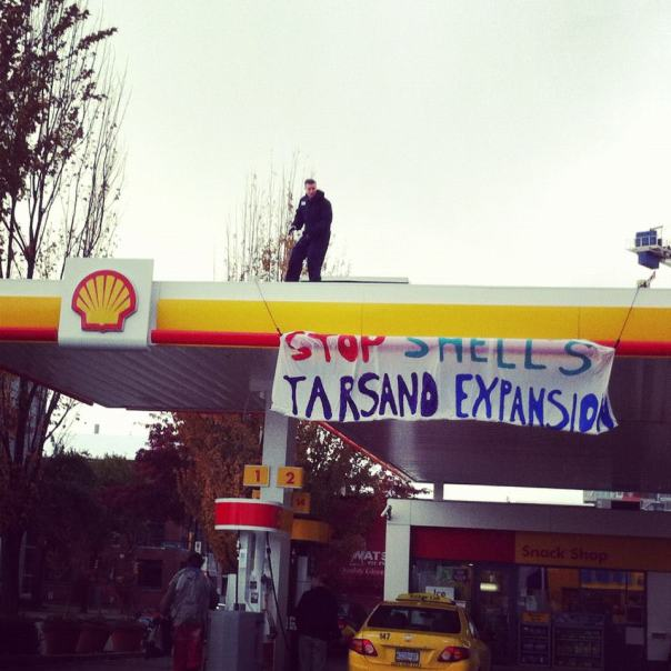 Banner drop on Shell station in Vancouver, Oct 23, 2012.