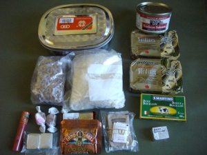 Example of 3 day rations. The items below the metal mess tin fit inside it and include rice and noodles.