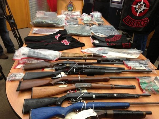Rifles and other items seized during raids against alleged members of the Manitoba Warriors gang.