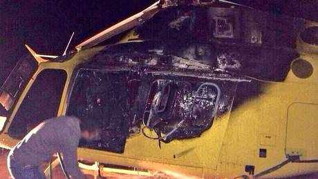Forestry company's helicopter after arson attack, Dec 31, 2013.