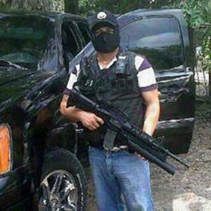 Member of the Knights Templar cartel armed with M16 and grenade launcher, Michoacan state.