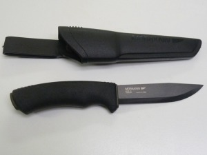 A Mora Bushcraft Black knife, with an approx. 4 inch long carbon steel blade.