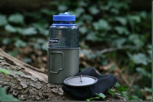 Nalgene water bottle with metal cup and lid.