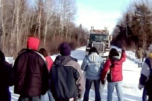 Grassy Narrows youth blockade logging trucks, 2002.