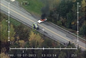 RCMP aerial surveillance of two more RCMP vehicles on fire, Oct 17, 2013.
