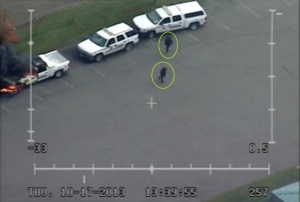 Surveillance footage from RCMP aircraft, apparently the best footage available of those who set RCMP vehicles on fire.