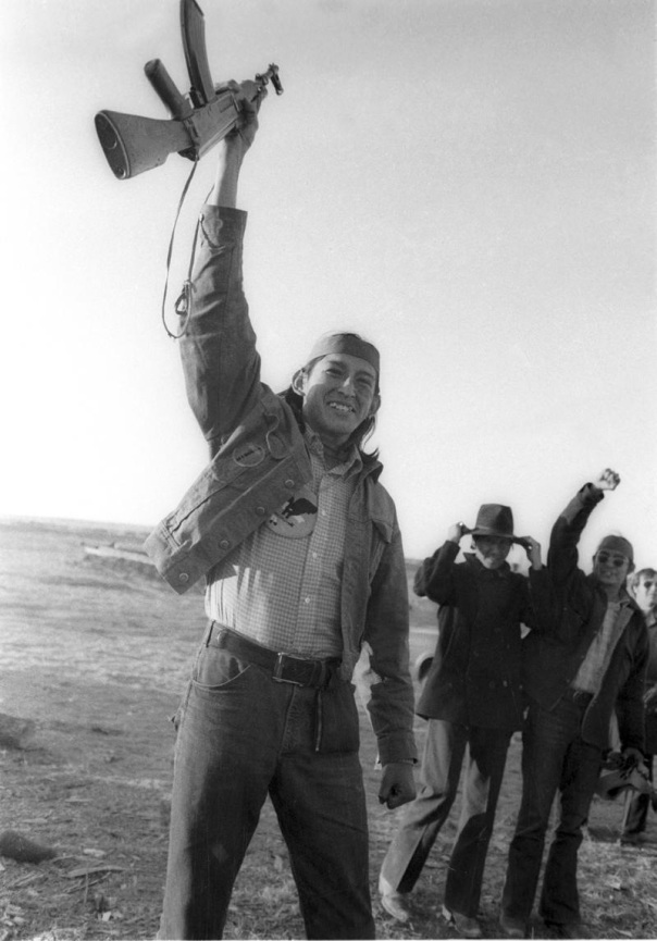 Robert Onco with his AK47 during the occupation of Wounded Knee, 1973.