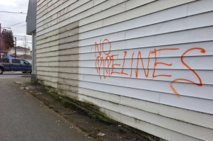 Anti-pipeline graffiti in East Vancouver, 2014.