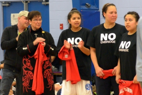 "Members of Haisla basketball team wear black ""No Enbridge"" t-shirts."