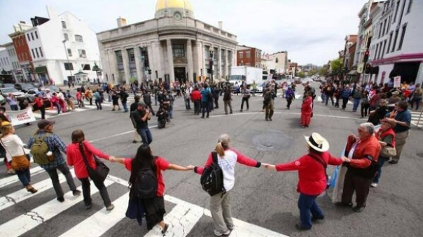 Cowboy and Indian Alliance members round dance in streets of Washington DC, April 2014.