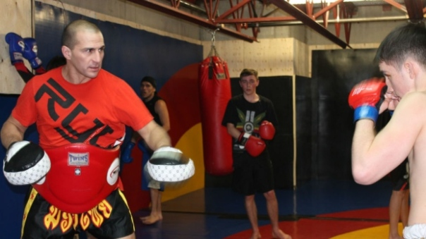 """Darwin Douglas from the Sto:lo nation teaching youth at the Four Directions gym in Cheam, """"BC."""""""