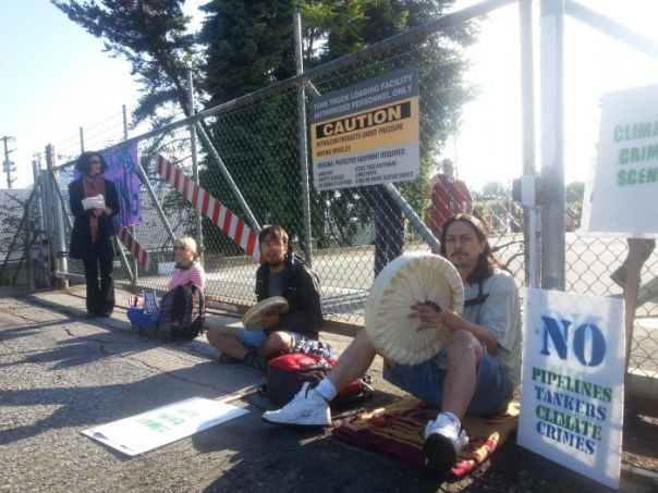Dan Wallace, Mia Nissen and Adam Gold locked down at Chevron's refinery in Burnaby, BC, May 30, 2014.