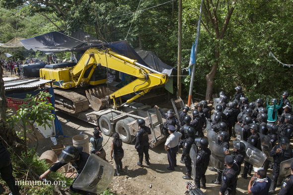 Riot cops eventually succeeded in moving in heavy machinery for the mining corporation.