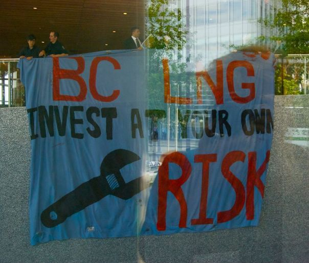 Banner dropped at International LNG in BC conference, May 21, 2013, by members of Rising Tide.