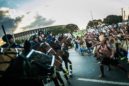 Natives clash with mounted riot cops, May 27, 2014.