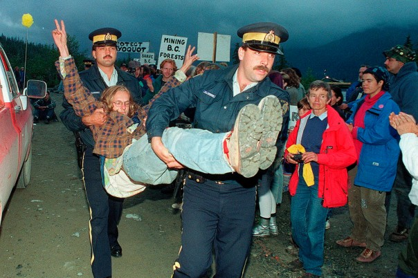 An anti-logging protestor is carried away by RCMP after being arrested for blocking Macmillan Bloedel logging trucks at the entrance to Clayoquot Valley on July 30, 1993.