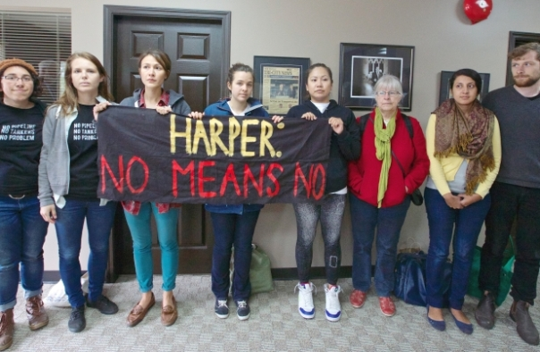 A group of women responded to the Enbridge decision  with a peaceful sit-in at Conservative MP James Moore's office in Port Moody, June 18, 2014.