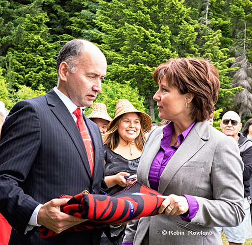 Haisla Nation Chief Counsellor Ellis Ross presents BC Premier Christy Clark with a gift to mark the sale of the hospital lands to the First Nation, June 2014.