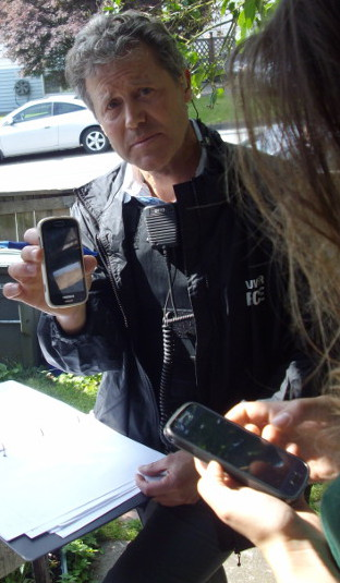 VPD detective constable Rainey with one of the stolen cell phones taken during the June 3 raid.