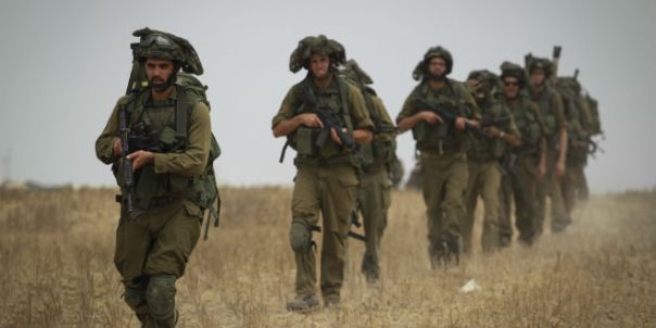 Israeli soldiers moving into Gaza Strip during Operation Protective Edge, July 2014.
