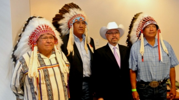 Chief Ernest Wesley of the Wesley Nation, Chief Bruce Labelle of the Chiniki Nation, the managing director of Huatong Petrochemical Holdings Ltd., Alick Au, and Chief Darcy Dixon of the Bearspaw Nation have signed a joint venture agreement to develop and explore Stoney Nakoda territory for oil and gas. (Terry Munro)