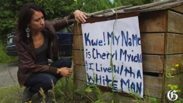 Cheryl Diabo with sign denouncing her relationship with a non-Native on the Kahnawake reserve near Montreal.