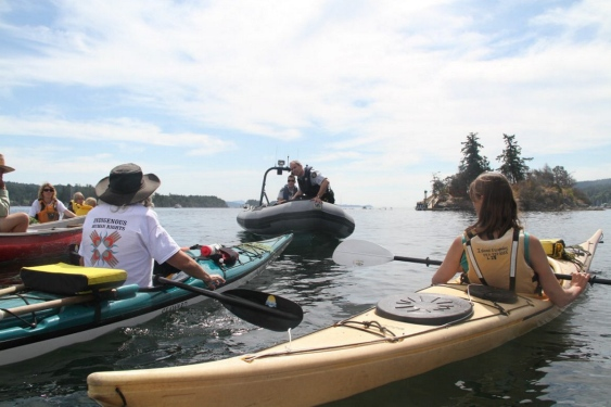 RCMP officers warn protesters near Grace Islet on Friday.
