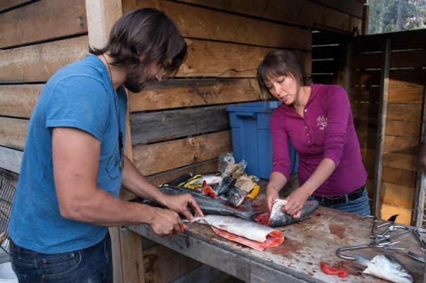 Moly and Cody prep salmon at the Unist'ot'en Camp. All photos via the author.