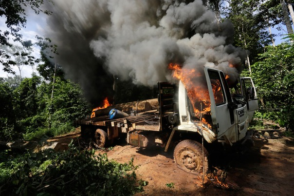 Logging truck set on fire.