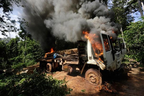 Logging truck set on fire.