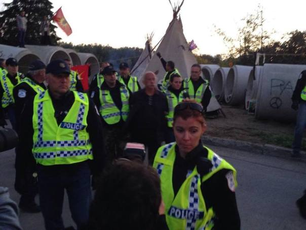 Police arresting one of the participants in the Algonquin camp, Sept 18, 2014.
