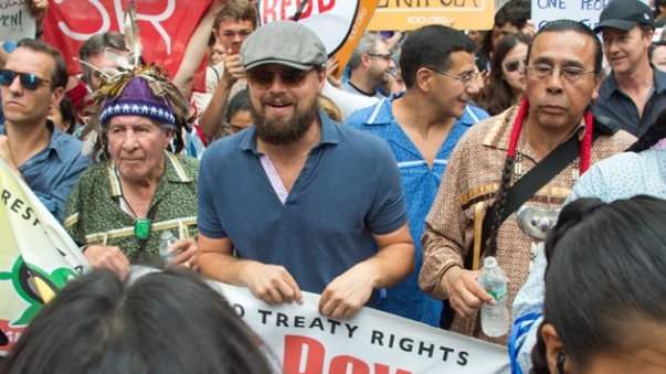 Leonardo Dicaprio marching with Indigenous people at rally against climate change, New York City, September 2014.