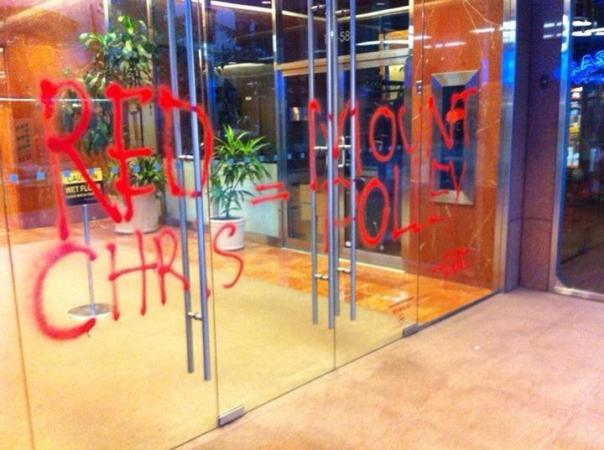 The building that houses Imperial Metals, located at 580 Hornby Street in Vancouver, BC, vandalized with graffiti.