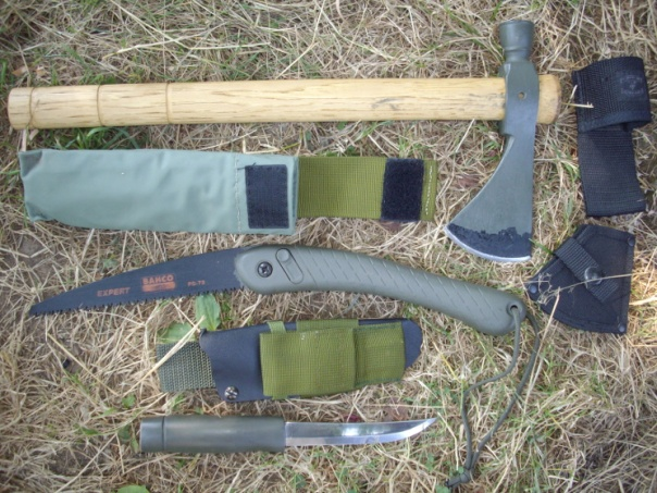 Wood processing kit: on top, a Cold Steel Pipehawk, in middle a Bahco Laplander folding saw, and on the bottom a Mora Forest Exclusive knife.