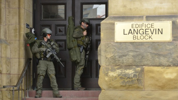 Two apparent snipers from the RCMP Emergency Response Team attempt to enter a building during the Jihadist attack in Ottawa, Oct 22, 2014.