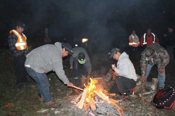 Members of the Tseshaht build fire at blockade.