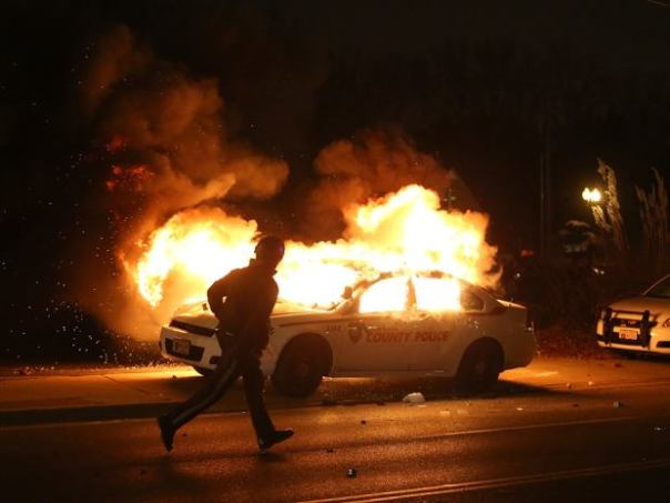 Police car burns in Ferguson, Missouri, on Nov 24, 2014.