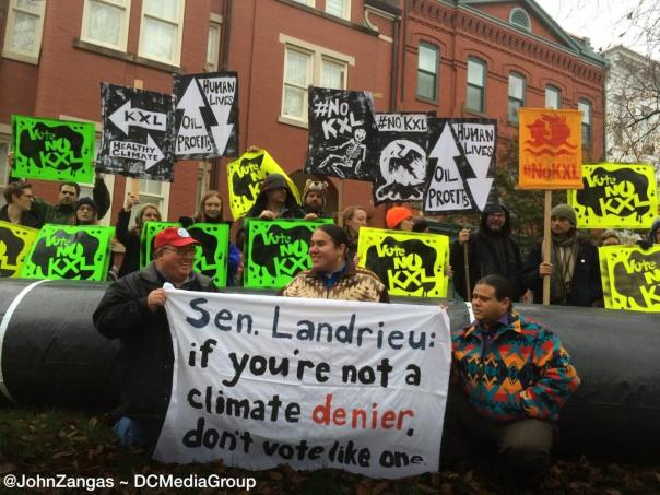 A pipeline has gone up on Sen Landrieu's front lawn as ClimateChange activists protest expected up vote, Nov 17, 2014.