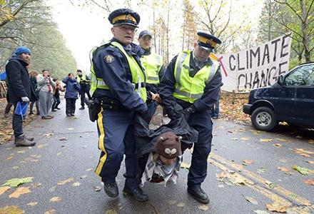 Another protester arrested and carried away; in total some 26 people were arrested on Nov 20, 2014.